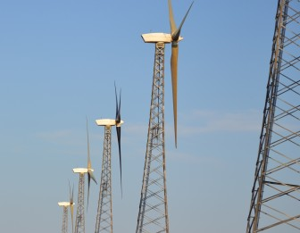Wind towers in a row, generating power north of Alta, Iowa. (IowaWatch photo by Robert Maharry)