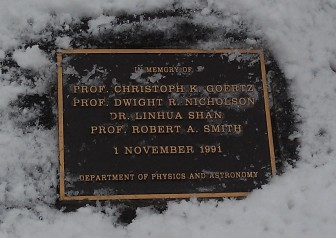 A plaque and wreath in late March 2013 are at the base of a tree planted as a memorial to members of the University of Iowa physics department killed in the Nov. 1, 1991, mass shooting on the UI campus.