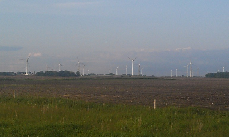 Wind towers dominate the landscape in northern Iowa in this photo, taken off Highway 218 in Floyd County in May 2013.