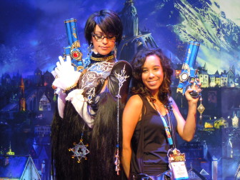A professional cosplayer of Bayonetta (left) and fan at Electronic Entertainment Expo (E3) in Los Angeles in June 2013. Cosplayers create costumes of their favorite characters and dress as them.