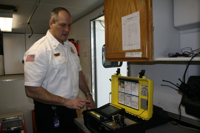 Greg Smith, Assistant Fire Chief for the Cedar Rapids Fire Department, demonstrated an instrument used for onsite chemical analysis during a hazmat emergency response.