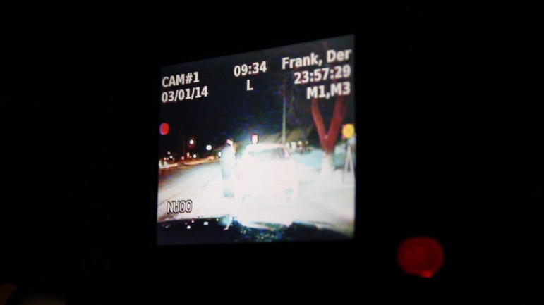 Iowa City Police Officer Derek Frank stops a taxicab driver in downtown Iowa City the night of March 1, 2014. This photo shows the image produced by a video camera that is taping the stop.