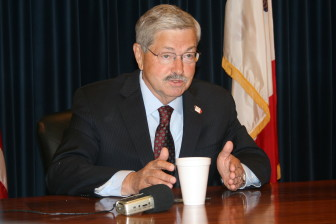 Iowa Gov. Terry Branstad, speaking with IowaWatch reporters at the Iowa Statehouse on Monday, July 7, 2014.