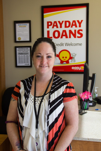 Amber Castle, an employee at Easy Cash Solutions in Cedar Rapids shown February 26.