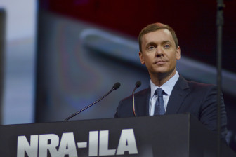 Chris Cox, executive director of NRA-ILA, the National Rifle Association's lobbying arm, addresses a crowd of more than 300 at the organization's leadership forum.