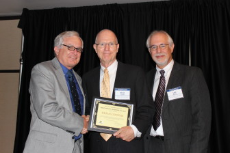 Telegraph Herald executive editor Brian Cooper receives IowaWatch's Stephen Berry Free Press Champion Award at the annual Celebrating a Free Press and Open Government Banquet, in Des Moines on Oct. 2, 2014, With Cooper are (left) IowaWatch cofounder Stephen Berry and (right) IowaWatch executive director-Editor Lyle Muller.