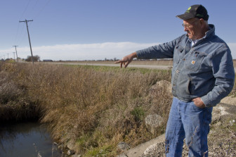 Champaign County, Illinois, grain farmer Lin Warfel points to a drainage area on his property on Nov. 5, 2014.