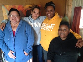 With Isaiah Newsome (right) are, from left to right, his aunt Kristine Minter; cousin Brandy Minter, and mother, Charice Williams.