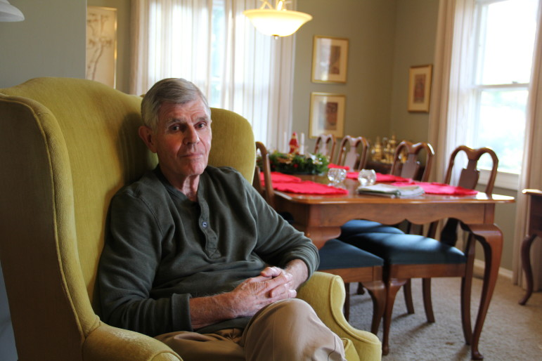 Frank Judisch, 78, posed in his Iowa City home on Dec. 6, 2014.