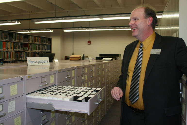 Anthony Jahn, archivist for the State Historical Society of Iowa, opens a drawer of newspaper microfilm in the State Historical Building Library in Des Moines on Feb. 17, 2015. The Des Moines archives include more than 30,000 rolls of microfilm.
