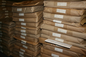 Newspapers bundled into Kraft paper waiting to be sent off for microfilming are shown in the State Historical Building Library in Des Moines on Feb. 17, 2015. Seven daily papers and 53 weeklies are currently preserved through partnerships between local libraries and the historical society.