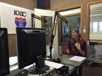 """IowaWatch's Lauren Mills speaking on KXIC radio's """"Your Town"""" program on Tuesday, March 17, 2015."""