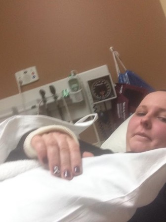 Katie Anthony recovers in a hospital emergency room with a broken wrist in this undated photo.