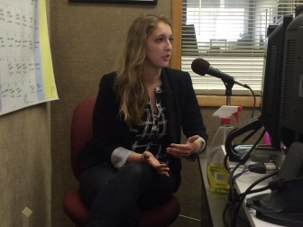 Meghan Horihan speaking on KXIC radio, Tuesday, April 21, 2015, during a monthly 'Our Town' segment featuring IowaWatch.