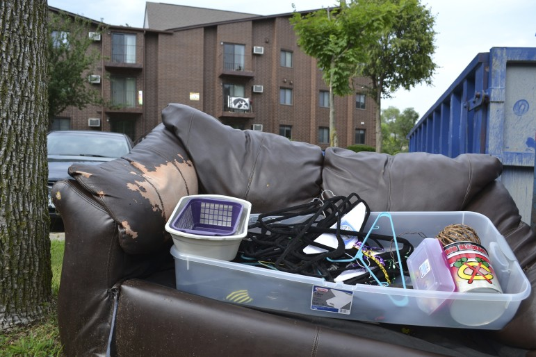 Dumpsters off of Gilbert Street in Iowa City overflow with furniture and trash as students move out on July 28, 2015. Most leases for apartments college students in Iowa City rent expire July 31, creating a massive amount of moving, dumping old furniture and fighting over getting back damage deposits.