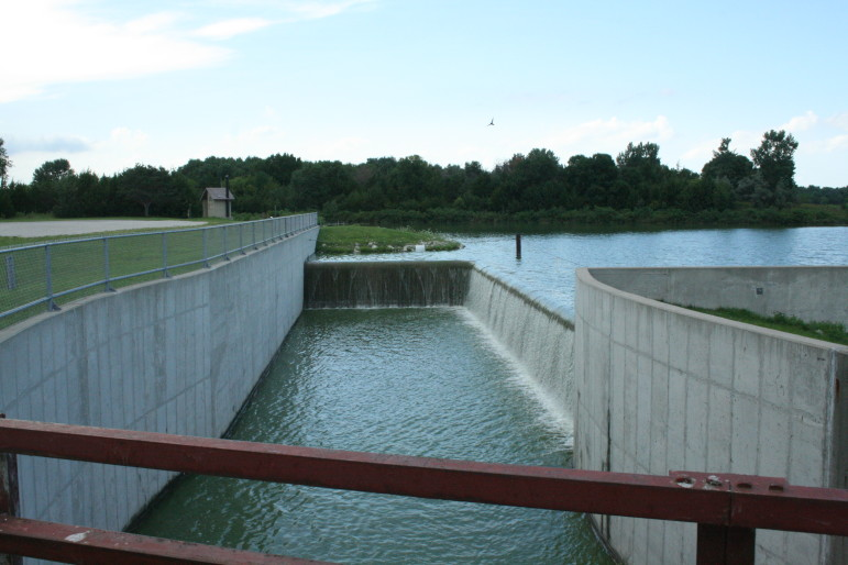 The Green Valley Lake spillway, pictured July 31, 2015, at the south end of the lake was rebuilt in 2009 as part of a lake restoration project. The previous spillway had developed structural problems and allowed common carp, a fish that contributes to poor water quality conditions, to enter the lake.