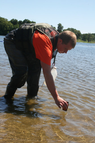 Connor Nicholas, 22, gathered a sample from Prairie Rose Lake on July 30, 2015 as part of the Iowa DNR beach monitoring program.