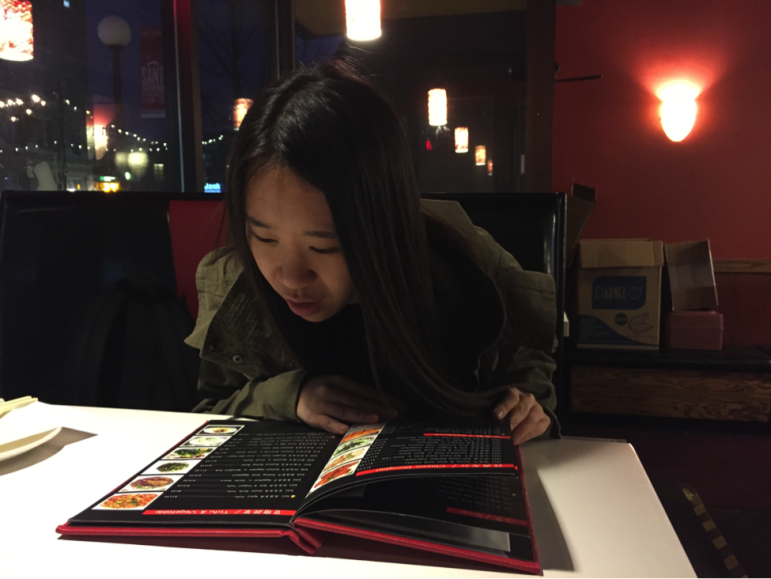 University of Iowa senior Jia Yuanfang, from Hebei, China and studying business and art, at Food Republic, a downtown Iowa City restaurant, in early December 2015. Jia says she has had trouble understanding professors because they use words and sayings she doesn't know.