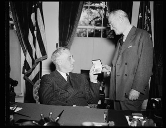 """President Franklin Roosevelt awarded George M. Cohan the Gold Medal for creating popular war songs during World War II. Mary Jane Walsh starred with Cohan in """"I'd Rather Be Right"""" where he portrayed the President in 1937."""