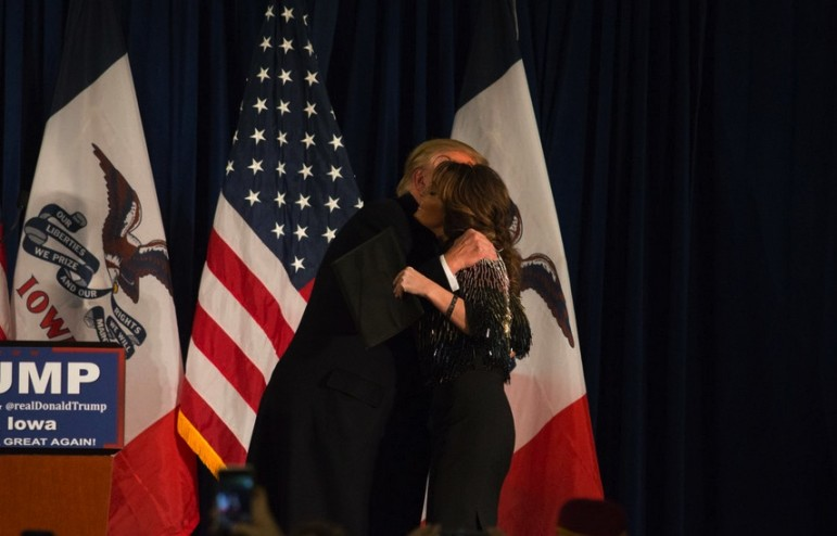 Republican presidential candidate Donald Trump and former vice presidential candidate and Alaska Gov. Sarah Palin hug before Palin delivers her endorsement of Trump in Ames on Jan. 19, 2016.