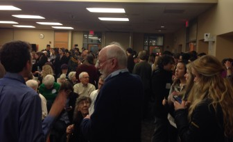 Democrats pack an Iowa City Public Library meeting room for the start of Tuesday night's Iowa presidential precinct caucuses.
