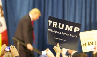 Signs show the hopes Donald Trump expressed for winning the Iowa Republican presidential precinct caucuses during this campaign stop at the University of Iowa Field House on Tuesday, Jan. 26, 2016.