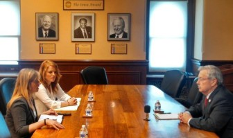 IowaWatch summer 2015 interns Makayla Tendall (left) and Clare McCarthy interview Iowa Gov. Terry Branstad in July 2015.