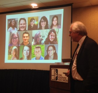 IowaWatch Executive Director-Editor Lyle Muller leads an Iowa College Media Association convention session on student journalists covering the 2016 Iowa precinct caucuses. Shown in the background are photos of some journalists covering the caucuses with IowaWatch. Photo taken Feb. 5, 2016.