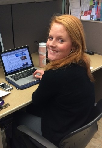 Clare McCarthy at work in the IowaWatch offices during her summer 2015 internship. McCarthy is also involved in IowaWatch's spring college media project.
