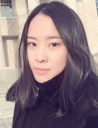 Wanjia Li, University of Iowa student, in front of Old Capitol on Feb. 4, 2016.