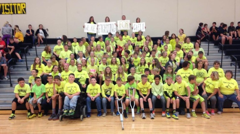 "Cael Rudkin's West Marshall elementary school classmates at a September 2014 fundraiser. They wore shirts that read, ""Fight for Cael"" to school on a Friday. This was in preparation for the Beaverdale Beaverdash, a run every fall in Des Moines that is a fundraiser for CureSMA, an organization for families with a child with Spinal Muscular Atrophy (SMA)."