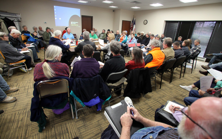 The Mine Reserve Expansion Study Committee meets in the Clayton County office building in Elkader, Iowa, on April 28, 2016. The committee was formed to determine the environmental, economic and aesthetic impacts of Pattison Sand's proposed mine expansion. More than 60 people attended the meeting, where two experts on air quality from the University of Iowa spoke.