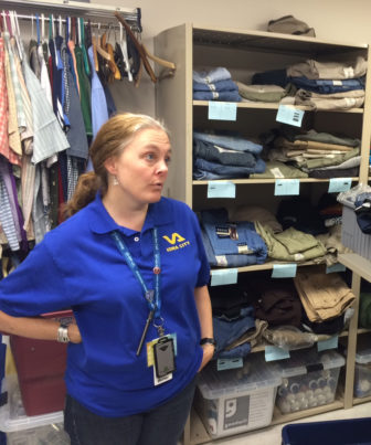 Sarah Oliver, homeless program coordinator in summer 2016, shows the clothing pantry at the Veterans Administration Homeless Outreach Center in Rock Island, Illinois, on June 9, 2016.