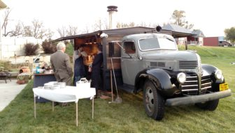 Provender sets up its wood-fired oven in preparation for the 2015 IowaWatch Fun-raiser and silent auction.
