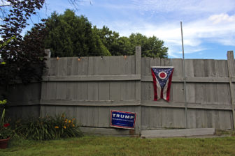 A Donald Trump campaign sign and Ohio state flag decorate the backyard of Kathy Miller, the Mahoning County chairwoman for Trump, in Boardman, Ohio. Miller is leading a grassroots movement encouraging Democratic voters to vote for Trump in November's general election.