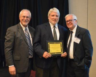 Des Moines Register engagement editor Clark Kauffman (center) receives the 2016 IowaWatch/Stephen Berry Free Press Champion Award during the annual Celebrating a Free Press and Open Government banquet Sept. 29, 2016. Berry, the IowaWatch co-founder for whom the award is named, is on the right. IowaWatch executive director and editor Lyle Muller is on the left.