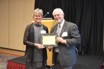 Pat Palmer receives the 2016 IowaWatch/Randy Brubaker Free Press Champion Award on behalf of her late husband, Harold Hammond, from IowaWatch executive director-editor Lyle Muller during the Celebrating a Free Press and Open Government Banquet.