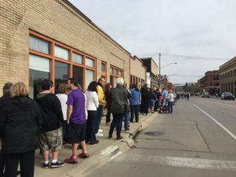 Supporters lined up in the Cedar Rapids New Bo Business District to see Democratic presidential candidate Hillary Clinton on Friday, Oct. 28, 2016,