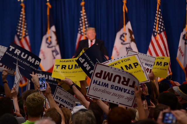 Students show support for Republican Donald Trump at a Jan. 26, 2016, rally in Iowa City, Iowa.