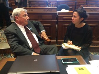 IowaWatch intern Krista Johnson, a University of Iowa senior journalism student, interviews Iowa state Rep. Andy McKean, R-Anamosa, on Jan. 10, 2017, on the Iowa House floor.